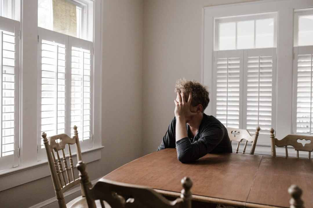 man with agoraphobia looking outside