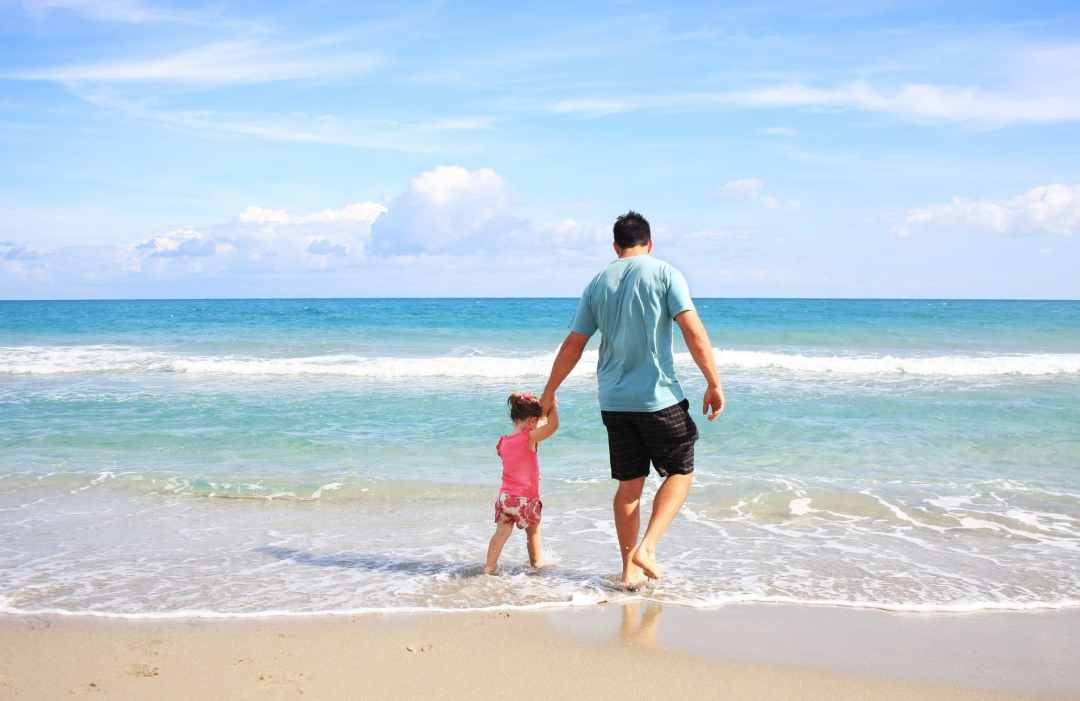 father and daughter in beach