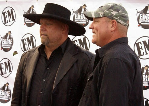 Eddie Montgomery and John Michael Montgomery celebrate the opening of Eddie Montgomery's Steakhouse. Photo by Jessica Blankenship.