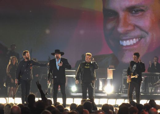 "Dierks Bentley, Eddie Montgomery, and Rascal Flatts perform ""My Town"" in honor of Troy Gentry at ""The 51st Annual CMA Awards."" Photo by Rick Diamond/Getty Images"