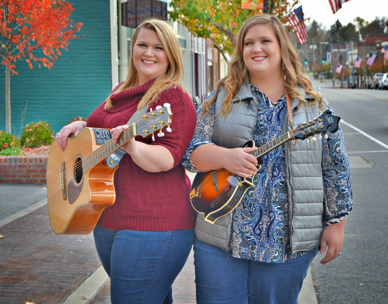 Sisters Rayna Warford and Ramsey Nicholson are making a name for themselves and their hometown, Lawrenceburg, with their new single.