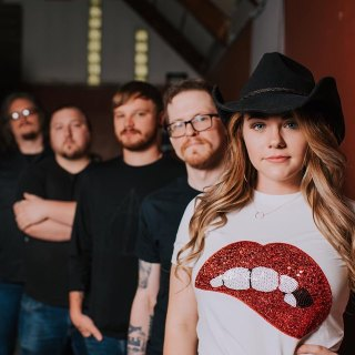 Sydney Adams with Band