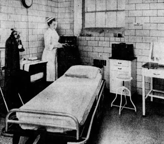 """Registered Nurse, Miss Helen Parrish in the electric shock room of the new outpatient department. Blakeslee, Dennis. """"Lady of Peace opens revamped facilities."""" The Courier-Journal, 13 February 1961, p. 13."""