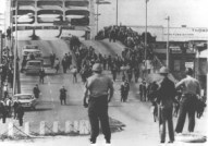 Police wait for marchers to come across the Edmund Pettus Bridge on Bloody Sunday, March 7, 1965.