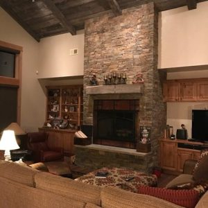 Montana reclaimed wood ceiling and mantel, floor to ceiling fireplace
