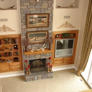 Two story fireplace with custom built-ins