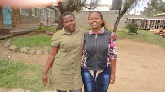 Quinter & Cynthia (class of 2014) in the courtyard of Mji Wa Neema children's home