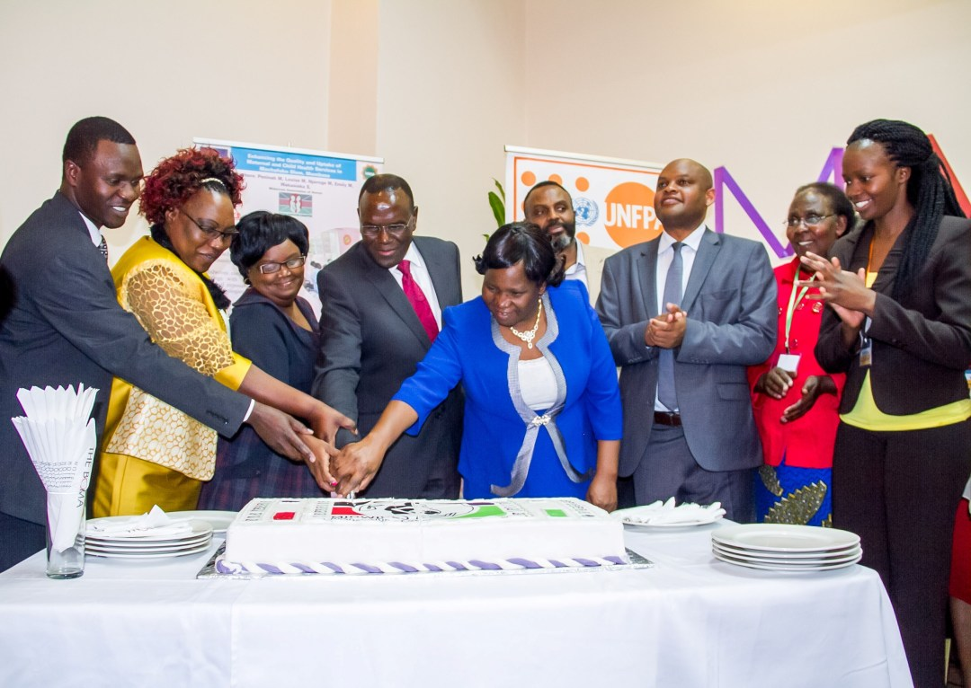 Health CS Dr. Cleopa Mailu cuts cake to mark the launch of MAK