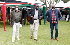 DP Ruto walks with Endebess MP Rober Pukose and Mt. Elgon's Fred Kapondi at his Sugoi home yesterday