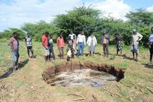 Ilchamus residents mill around a giant sink hole