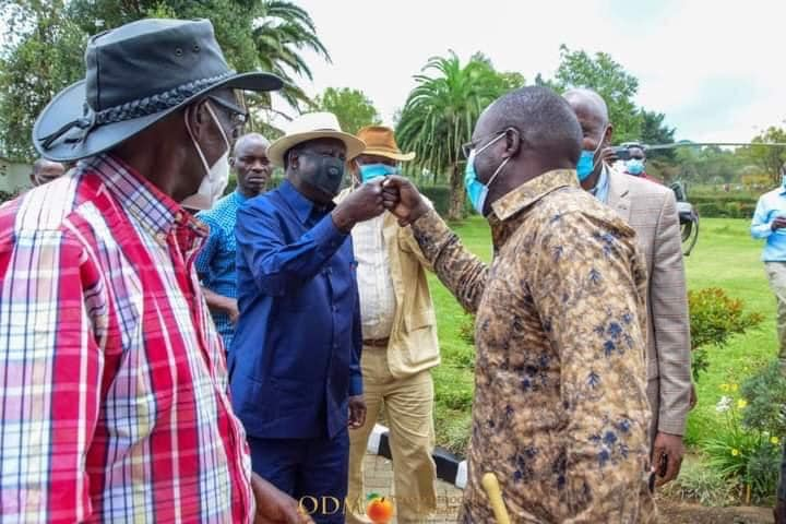 Odinga fist bumps MP Johanna Ng'eno at Sossion's home in Bomet.