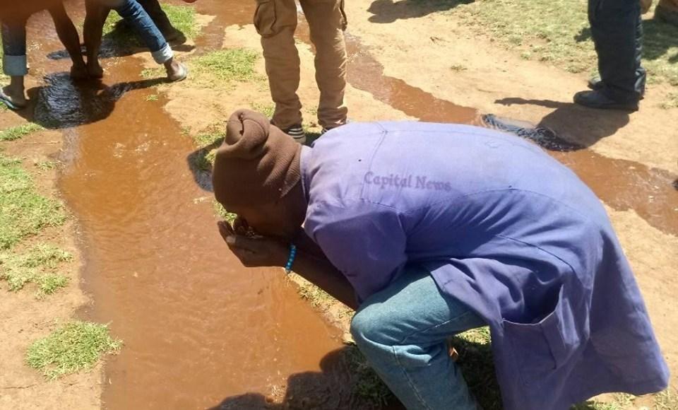 , Youth Scramble for Spilt Illicit Brew (Photos)
