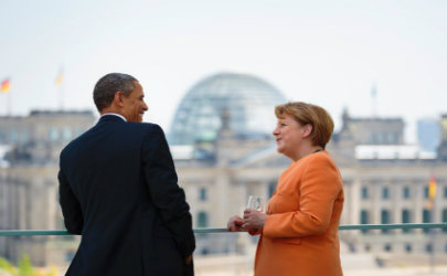 Obama and Merkel with the Berlin Parliament in the background