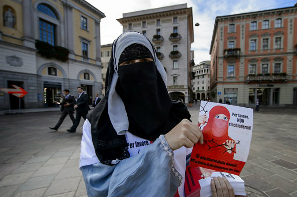 Member of Islamic Central Council of Switzerland member distributes flyers in Lugano against veil ban [AFP]