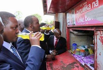 president uhuru taking soda