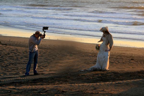 Photographer at ocean beach