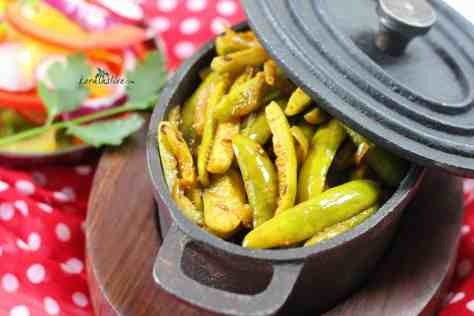 Kovakka Mezhukkupuratty (spicy Ivy gourd Fry) -Mezhukkupuratti is a style of cooking vegetarian dishes in Kerala. The vegetable are stir-fried with spices, Chopped onions and tempered.