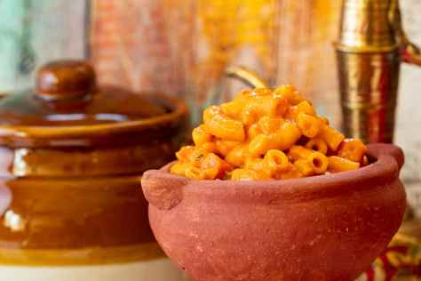 Indian macaroni cheese in a clay pot