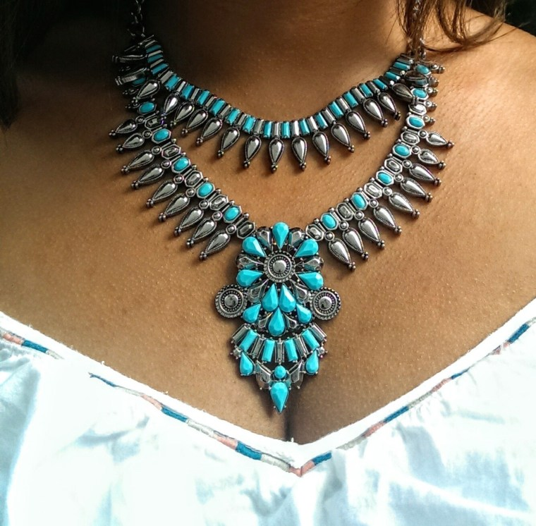 Turquoise and Silver statement necklace with a white dress