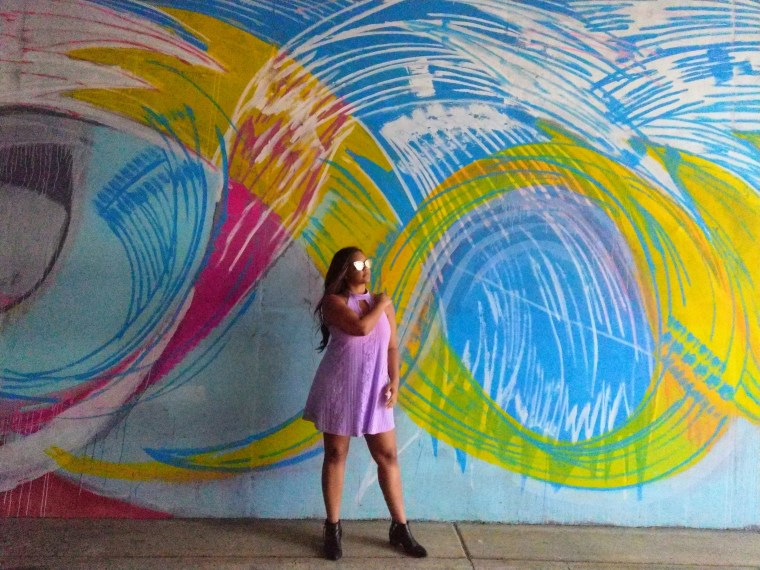 Atlanta street style and graffiti with black ankle boots, bvlgari sunglasses and a lavender dress