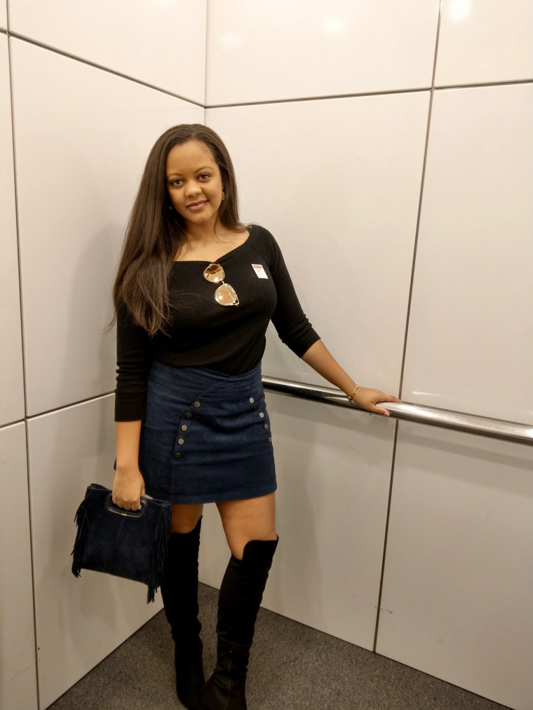 Black girl, beautiful woman, black woman in 20s, Keri Elaine, BCBGMaxazria, black over the knee boots, blgvari sunglasses, Maje navy fringe bag.