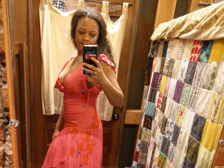 Pink floral dress, eclectic dressing room, curly hair