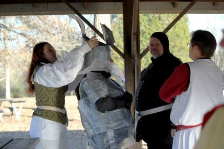 So, here I am, getting some help dressing out. After 11 years of helping my husband get into his armor, he got to help me get into mine. I even got the squire treatment as my husband's squire, Baron Fenwick, helped me into my bubblewrap maile shirt (it's not easy to get into, let me tell you--mainly because you don't want to tear it. Or pop it).