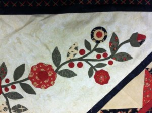 A close-up of the hand-sewn applique Nell designed.