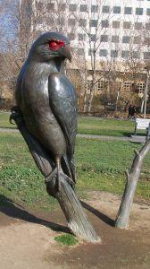 Giant hawk statue near Monopoly Board.