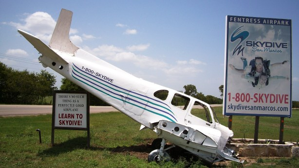 Crashed airplane as advertisement for skydiving.