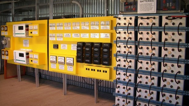 Banks of batteries for self-sustaining, off-grid compound.