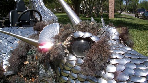 This car is made of spoons, forks, and other pieces of scrap metal.