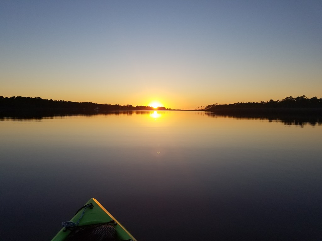 Sunset and the evening glass by kayak