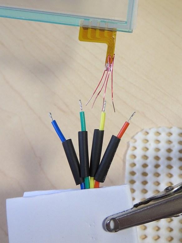 Ready To Solder 24-Gauge Hookup Wires To 30-Gauge Magnet Wires