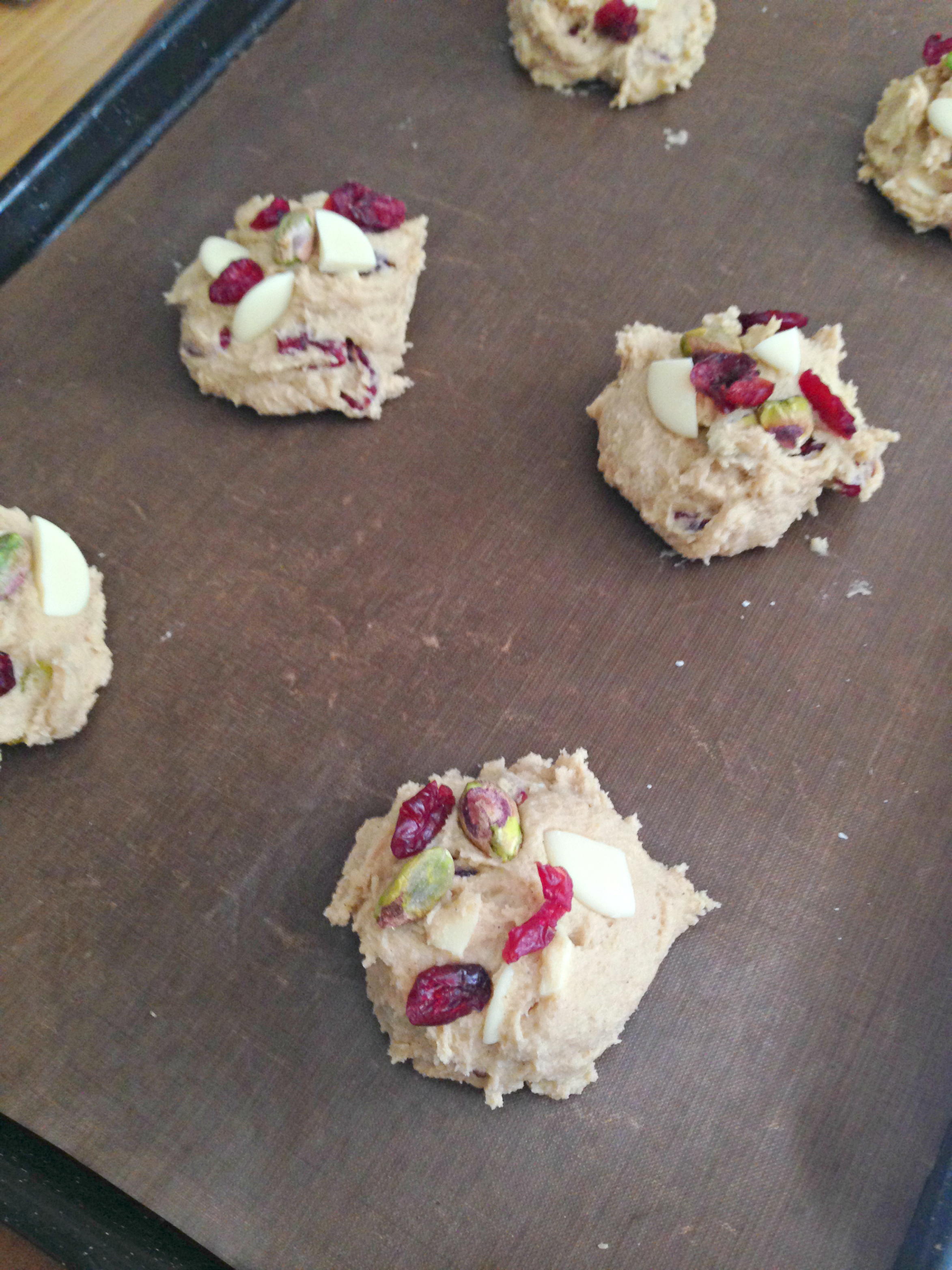 Cranberry, Pistachio and White Chocolate Cookies - Ease into the festive season with these gorgeously soft and chewy cranberry, pistachio and white chocolate cookies! Delicately spiced with a little ginger and cinnamon, they're incredibly moreish and a little bit Christmassy!
