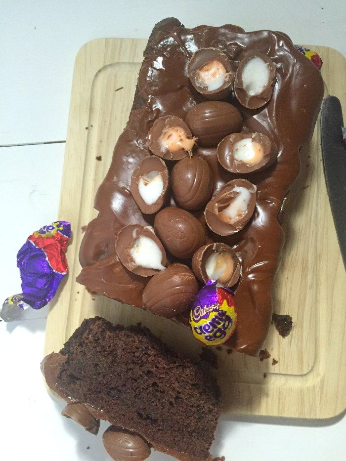 Fudgy, rich chocolate loaf cake topped with a chocolate glaze and Cadbury Creme Eggs. Easy, quick and simple to make! Creme Egg Chocolate Loaf Cake
