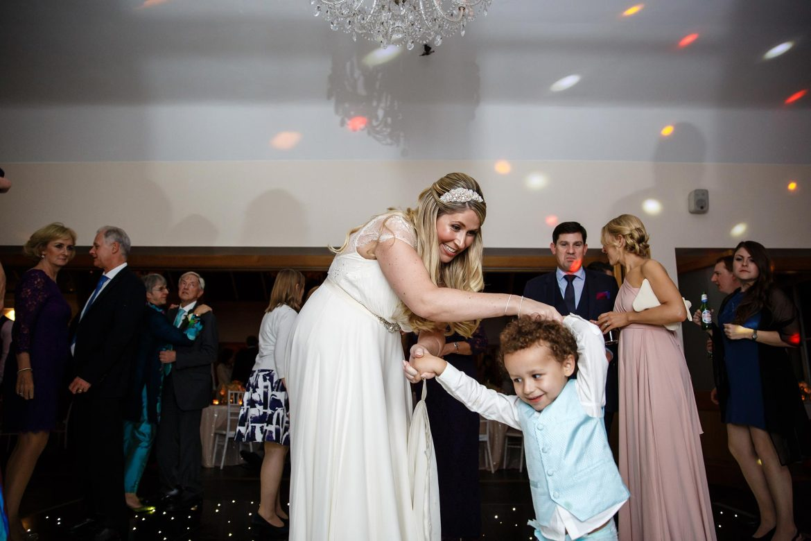 bride dancing with page boy