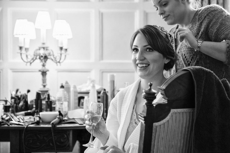 bride sips champagne