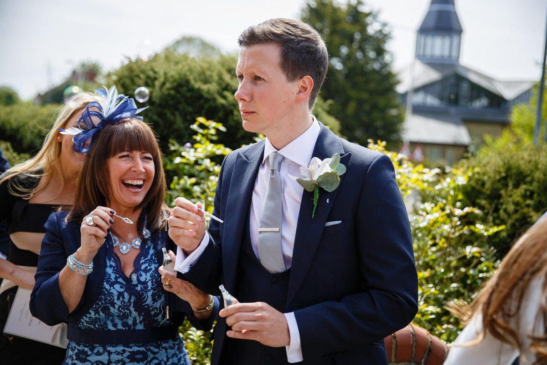 wedding bubbles laughter