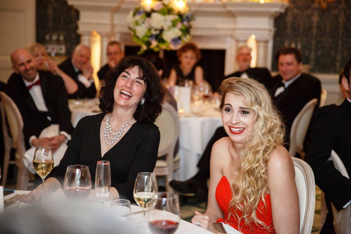 guests laughing at claridges wedding