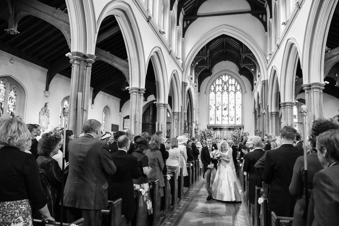 The couple continue down the aisle