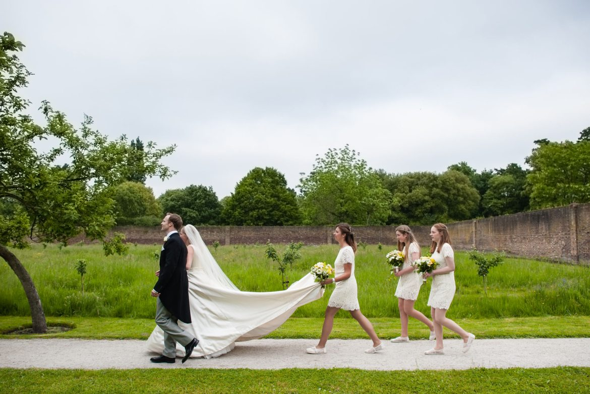The bride and groom enter the garden at Fulham Palace.