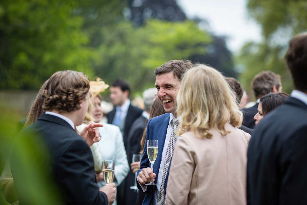guest at Fulham Palace Wedding laughing
