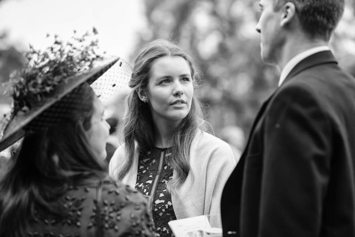 pretty wedding guests listens to her friend