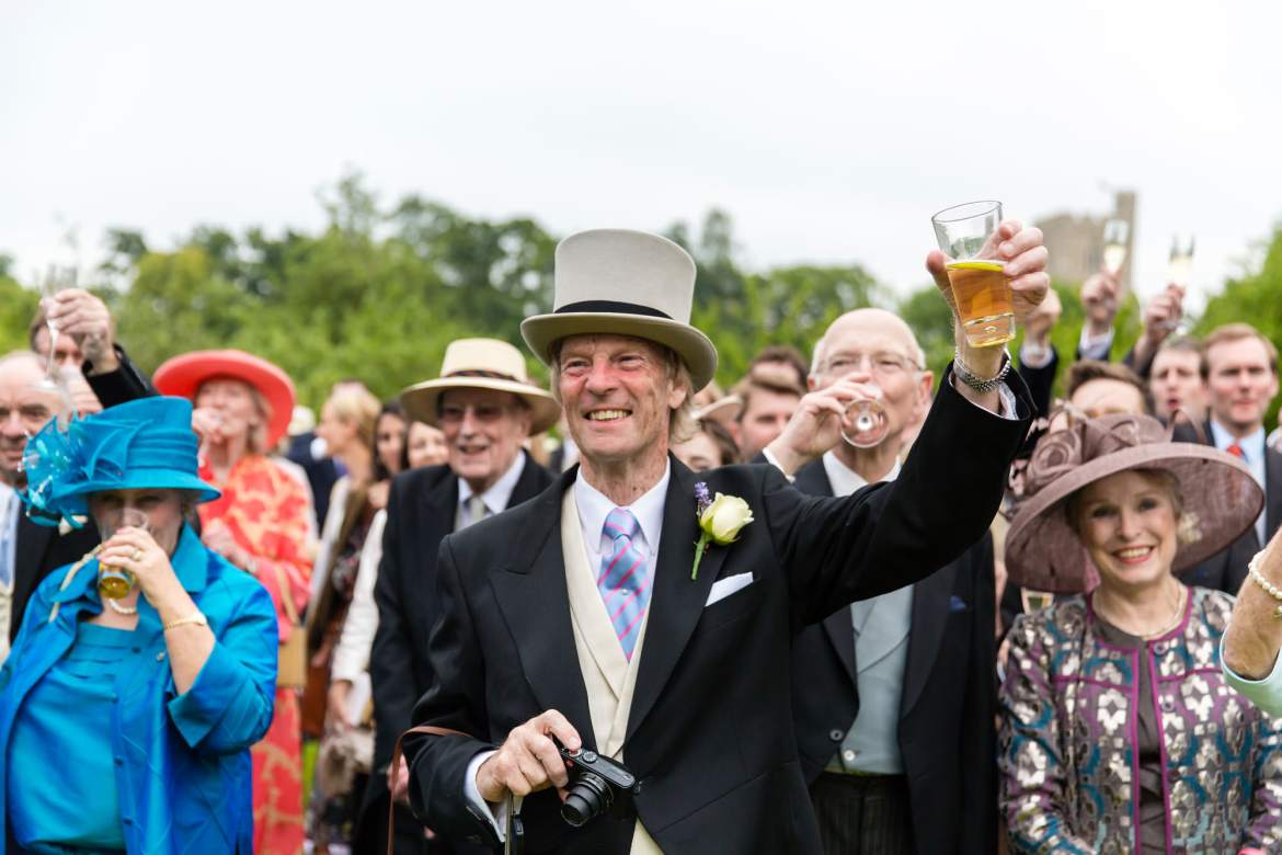 The guests raise their glasses in a toast