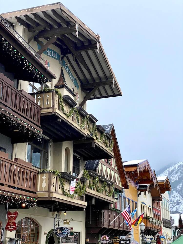 The wide awnings of buildings in downtown Leavenworth highlight the German theme of the town, with holiday lights still dripping from the wooden deckings, ornate with carved designs.