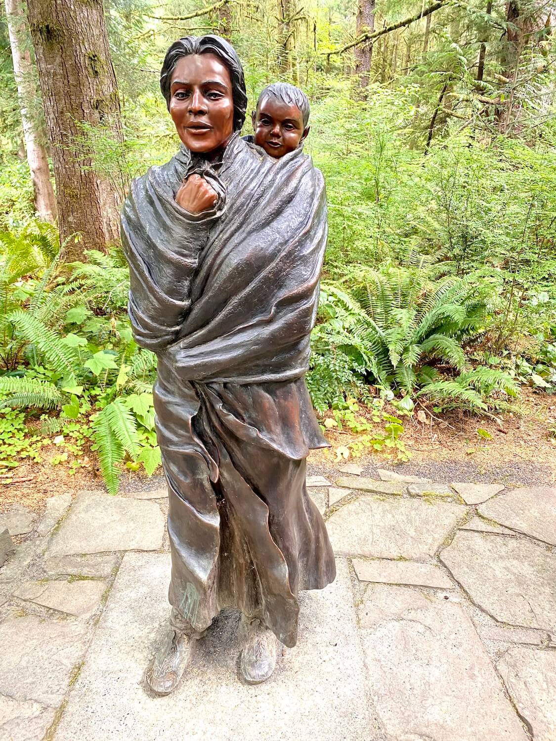 Pacific Northwest travel offers many ways to learn more about the people who inhabited this land for millennia before the first settlers. Here is a bronze statue of Sacagaweja, known for being instrumental in assisting the Lewis and Clark expedition.
