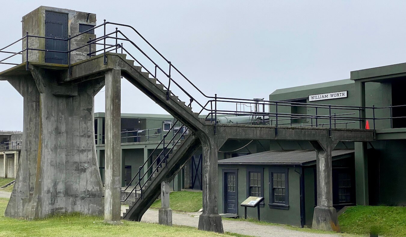 A newly painted battery at Fort Casey on Whidbey Island depicts the way this would've looked during World War Two, with concrete and metal structures creating geometric lines. The fort is painted a hunter green with a dark black trim.