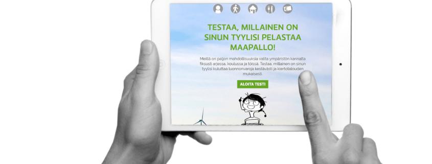Kuvassa iPad käsissä. Ruudulla teksti: testaa millainen on sinun tyylisi pelastaa maapallo!