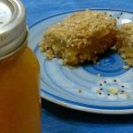 peach almond oat bars next to a jar of peach jam